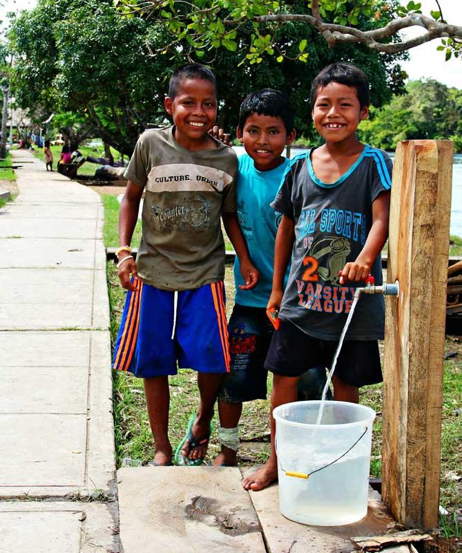 peru-boys-clean-water-spigot